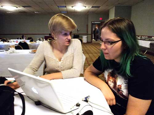 MNSBC.com multimedia producer Carissa Ray works with Laura Joy, providing tips on video storytelling.