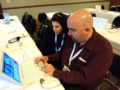 Jody Biehl, SUNY-Buffalo, works with workshop pro Jim Hayes of Vanderbilt Student Media as they edit video.