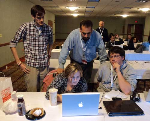 From left, Patrick Armstrong, Chasity Webb, Seth Gitner, workshop pro, and Brian Dulle watch the team's finished video.